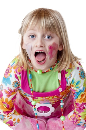Blond disguised girl with painted cheeks cries out loudly.Isolated on white background. photo