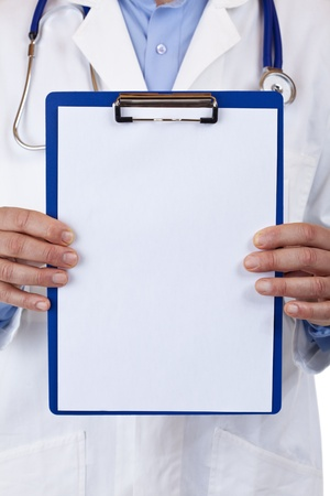 close-up of a clipboard with blank copyspace, held by medical doctor. Isolated on white background. photo
