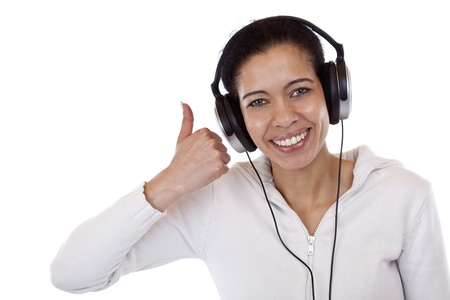 Attractive, smiling black woman with headset shows thumb up. Isolated on white background. photo