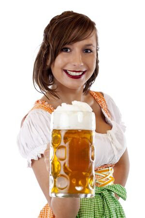 Smiling woman with dirndl  holds Oktoberfest beer stein. Isolated on white background.