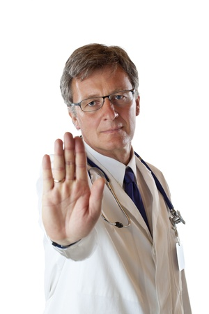rejections: Serious Physician shows stop sign  because of risk of infection. Isolated on white background.