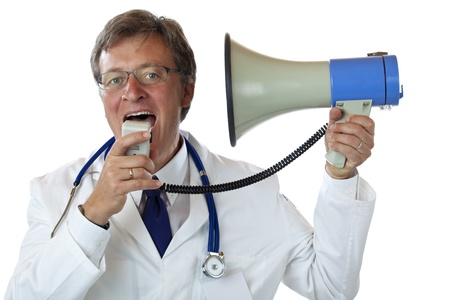 Elderly doctor screams into his own ears with megaphone. Isolated on white background. photo