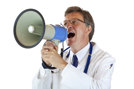 Elderly handsome Doctor shouts loudly in megaphone. Isolated on white background. Stock Photo - 9752051