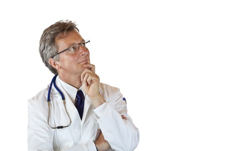 perplexity: Aged medical doctor with hand on chin looks contemplative up. Isolated on white background.