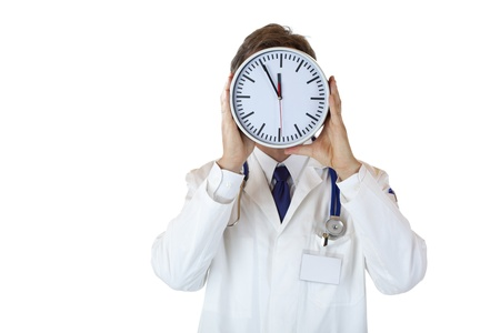 doctor burnout: Stressed doctor with clock in front of face as sign of time pressure.Isolated on white background.