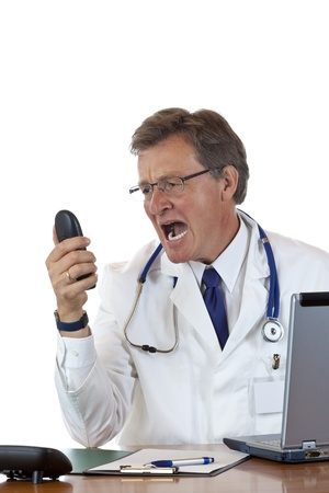 enraged: Enraged chief doctor screams loud into phone.Isolated on white background.