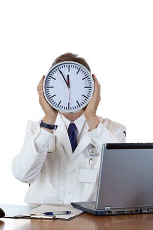 doctor burnout: Stressed medical holds clock in front of face because of time pressure.Isolated on white background.