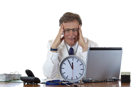 doctor burnout: Stressed medical with clock in front has headache out of time pressure. Isolated on white background.