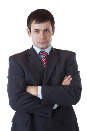 cautious: Young ambitious businessman looks at camera earnestly.Isolated on white background.