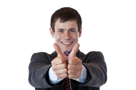 ambos: Exitoso empresario joven sostiene ambos pulgares.Aisladas sobre fondo blanco.