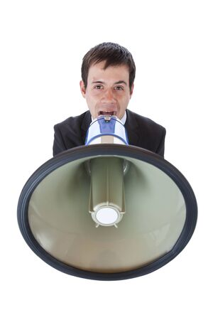 Closeup of a businessman roaring loudly into megaphone.Isolated on white background. photo