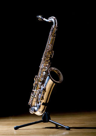 A tenor saxophone on a sax stand photo