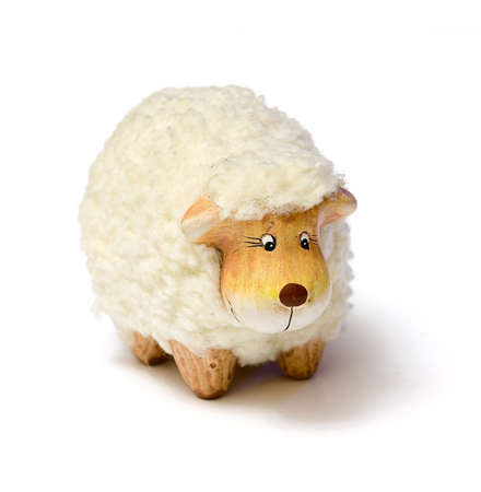 White sheep toy isolated on a white background with shadow photo