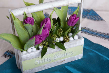 Bouquet of purple tulips on a table in interior photo
