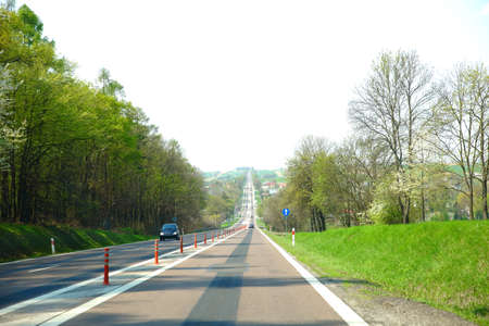 A long and straight section of a public road near Piaski.