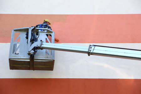Painting the facade from a height using a special jib.
