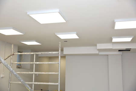Suspended ceiling with modern LED lighting. Stock Photo - 117094301
