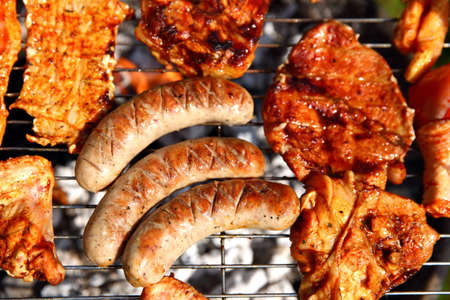 Meat and sausage on the grill. Stock Photo