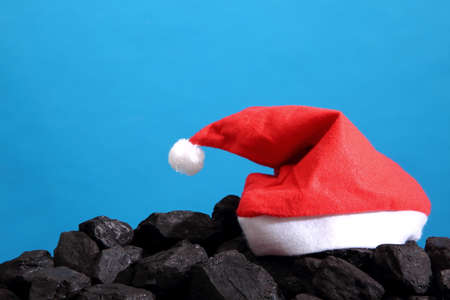 christmas symbols on a black coal heap.