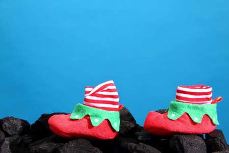 christmas symbols on a black coal heap.