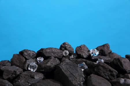 Black coal is strewn on a polished diamonds.