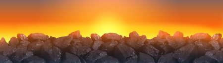 Black coal in the glow of the setting sun. Banco de Imagens