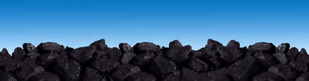 A pile of black coal on an isolated background.