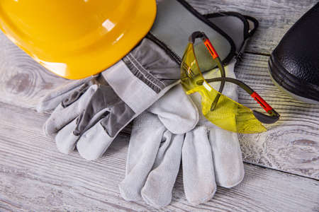 A helmet and safety shoes are essential personal accessories for every employee in the profession of a builder.