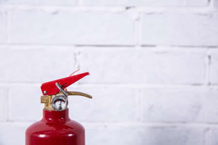 A fire extinguisher is a preventive measure necessary in areas of fire.
