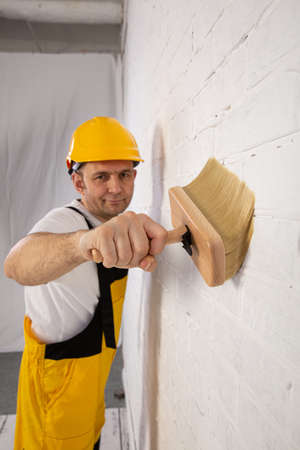 Painting the entire wall with a thick brush or paint roller.