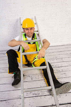 A professional builder with a ladder, compact and ready to work at any time.