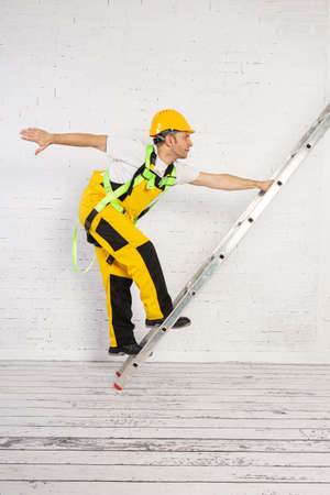 Irresponsible use of a ladder during construction work.