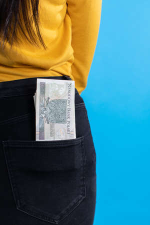 A cash file in the back pocket is a sign of financial wealth.
