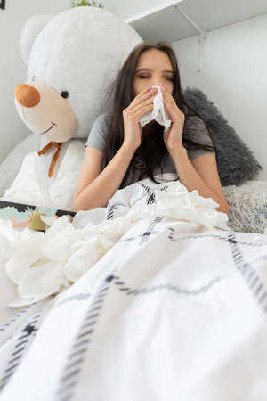A severe cold causing a headache and the need to constantly wipe the nose.