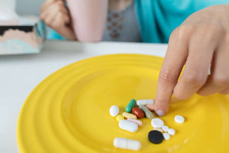 Pills and vitamins to be swallowed during chronic illness and high body temperature.