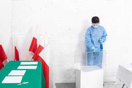Employee wearing a special suit. Disinfection of all surfaces. Presidential election. Stock Photo
