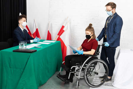 A woman in a wheelchair. Presidential elections in Poland. Polling station adapted for invalids.
