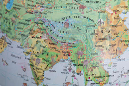 Close up continents with drawn borders and place names, as well as inhabiting animals. Фото со стока