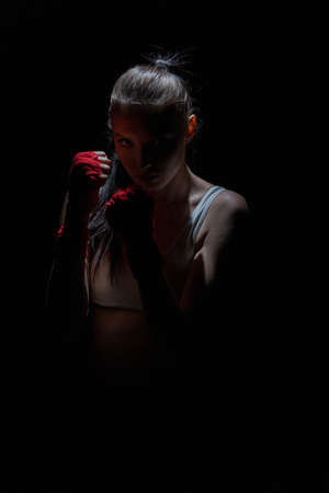 Contact and sharp sport in the ring for both women and men. Mixed Martial Arts. 版權商用圖片