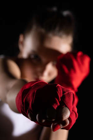 A strong punch with the fist straight ahead to the target. The athlete focused during training just before entering the ring boards.