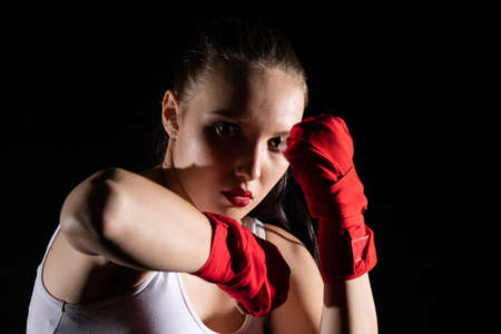Combination of elbow punches in a sport called MMA for short. Professional player of mixed martial art. Strong woman.
