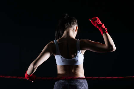 The MMA fighter won her first fight. The woman raised her hands in evidence of winning the fight.