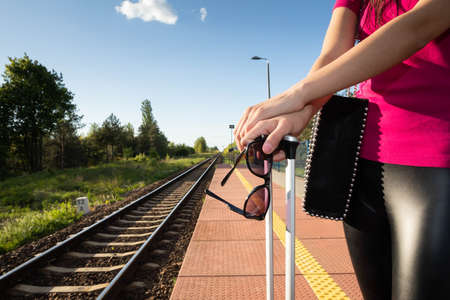 Hot summer when traveling by rail requires at least sunglasses and a good mood. Stok Fotoğraf