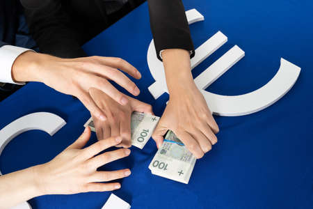 Many hands reach for banknotes handed out by government institutions to individuals and companies affected by the crisis due to the coronavirus.