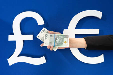A stack of banknotes in the palm of your hand as a sign of readiness and changes in cash circulation throughout Europe.