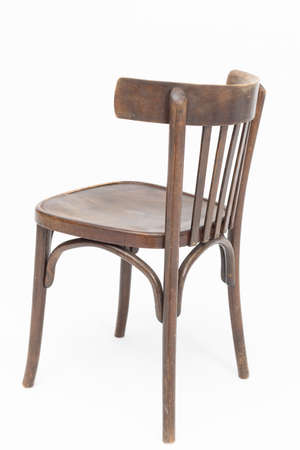 Wooden chair from turn of 70s and 80s from previous century in brown color. Polish design and production. Rear view