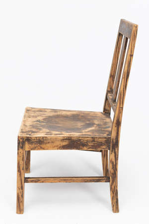 Wooden chair from the turn of the 70s and 80s from the previous century with rustic color. Short legs. Polish design and production. View from the side Stockfoto
