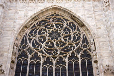 gothic window: Rosette on the Duomo, famous cathedral i Milan, Italy.