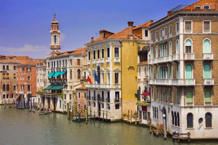 Old, colorful buildings along the canal in Venice, Italy