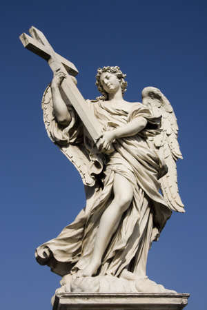 Statue of an angel holding a cross on the Sant Angelo Bridge in Rome, Italy